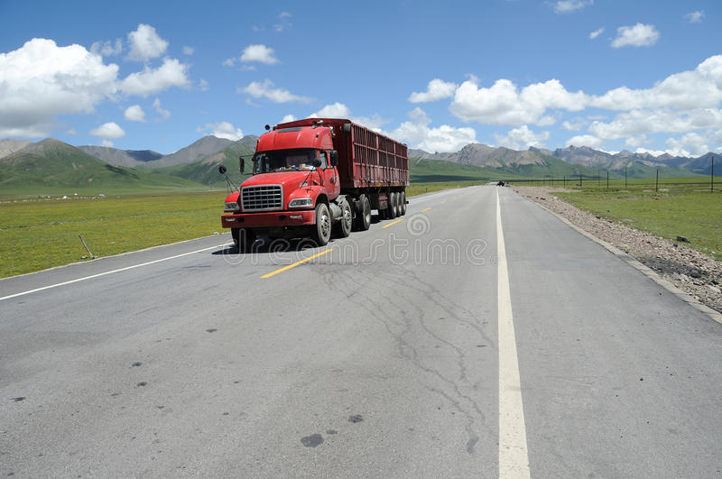 Download Red truck on the road stock image. Image of green, environment - 26011349
