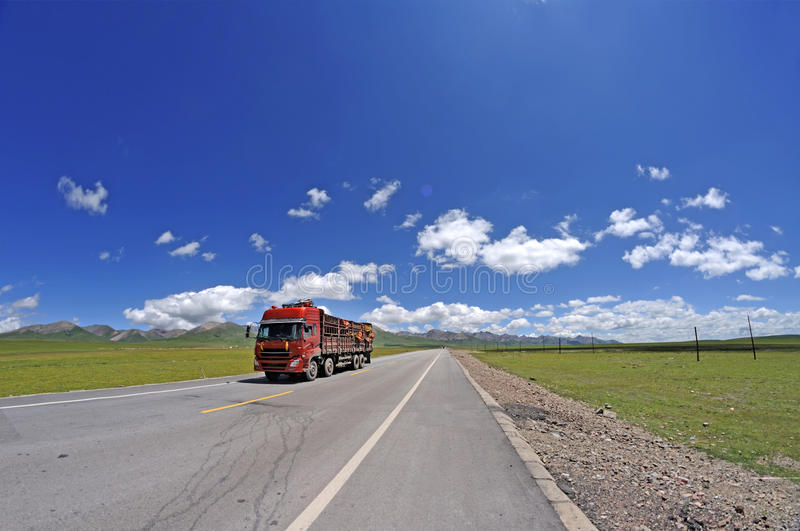 Download Red truck on the road stock photo. Image of emptiness - 26130354