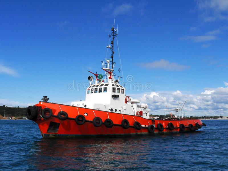 Red Tug Anchored in Bay. royalty free stock photography