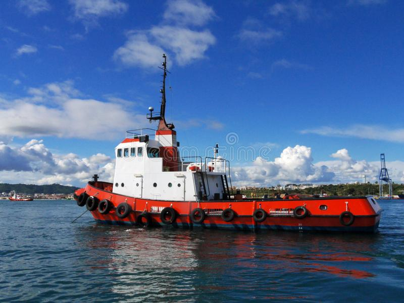 Red Tug at Anchorage in Bay. stock images