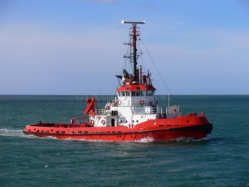 Red Tugboat Underway at Sea. royalty free stock images