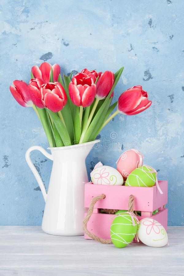 Red tulip flowers and easter eggs royalty free stock photos
