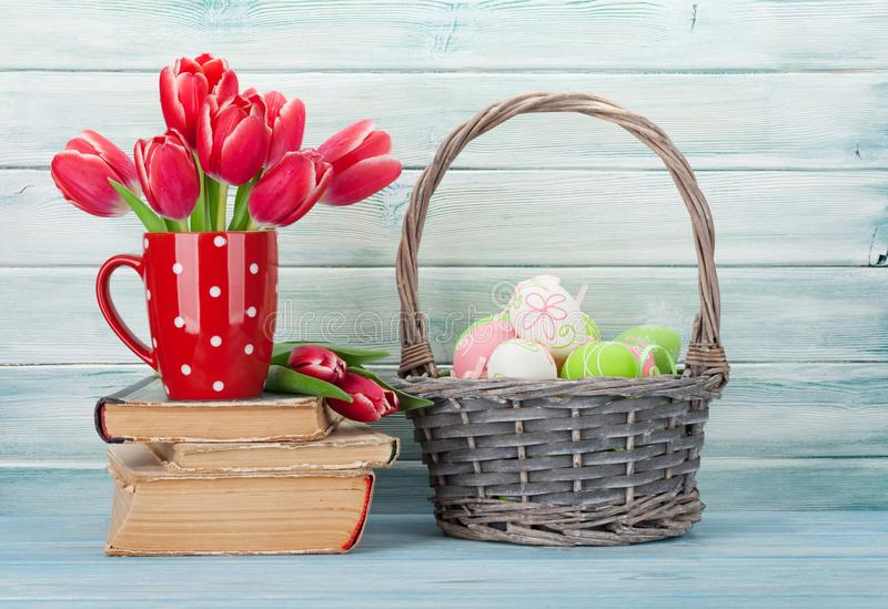 Red tulip flowers and easter eggs stock photos