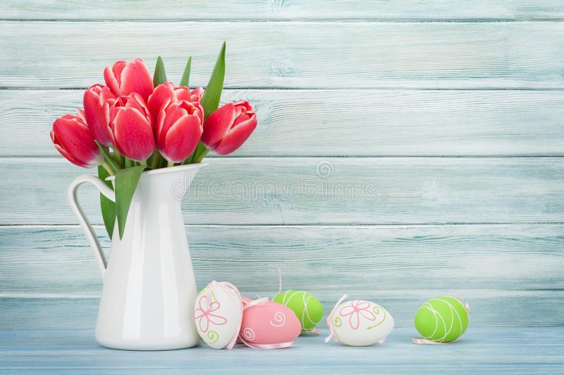 Red tulip flowers and easter eggs royalty free stock image