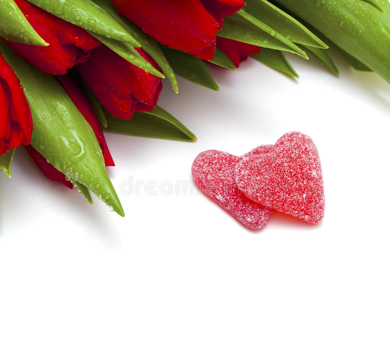 Free Red Tulips And Two Heart-shaped Candies Royalty Free Stock Image - 23145826