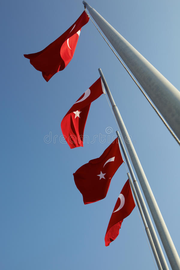 Red Turkish flags. Blowing in the wind on a clear blue sky day royalty free stock photography