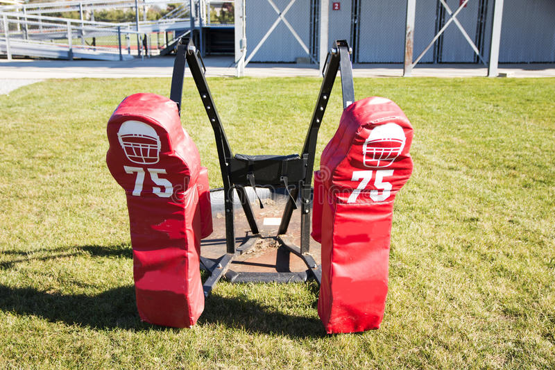 Red two person football sled. Two person push sled for football training stock photos
