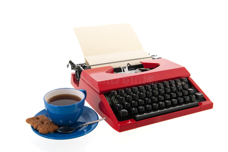 Red typewriter with blank paper. Vintage red typewriter with blank paper isolated over white background stock image