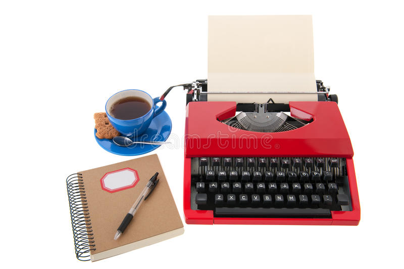 Red typewriter with blank paper. Vintage red typewriter with blank paper isolated over white background stock photo