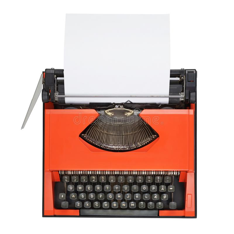 Red typewriter with Danish keyboard isolated. Red typewriter with Danish keyboard and empty paper sheet isolated on white background stock photo