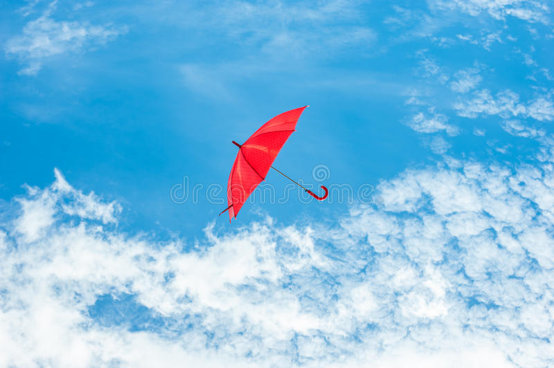 Red Umbrella with Blue Sky. Red Umbrella floating on Blue Sky stock images