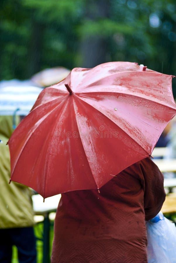 Red umbrella on rainy day royalty free stock photography