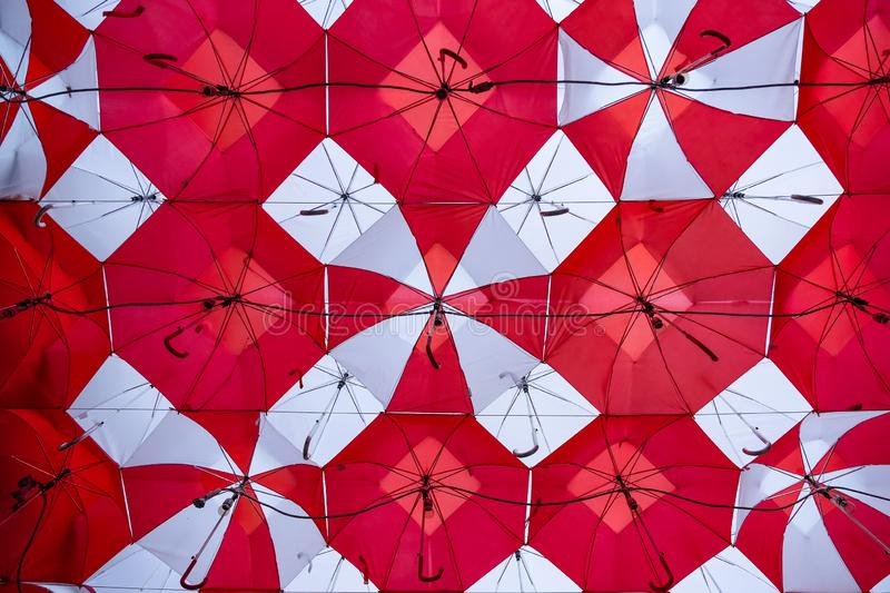 Red Umbrellas Open to Block Out The SUn royalty free stock photography