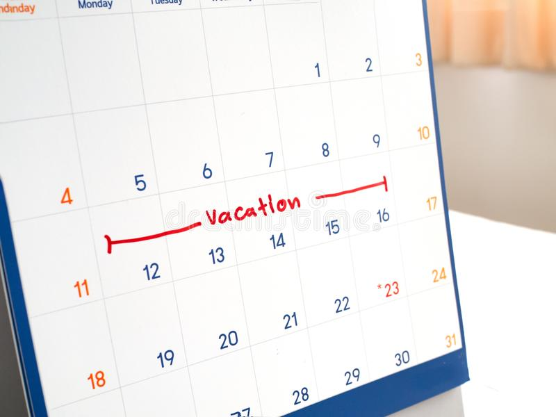 Red vacation write on white calendar marked for remember and target time to long vacation and relax time.  stock image