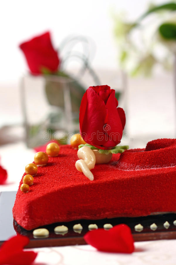 Red valentine cake. With roses stock image