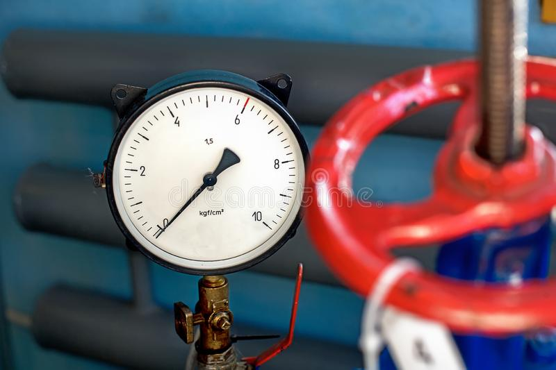 Red valve and pressure sensor on the gas supply or heating pipe. royalty free stock photography
