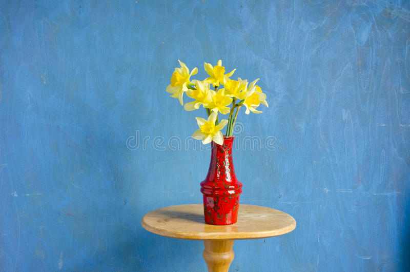Download Red Vase With Spring Narcissus On Table Stock Image - Image: 26465481
