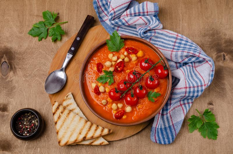Red vegetable soup with chickpeas royalty free stock photos