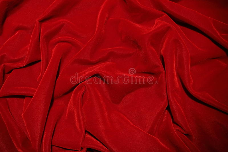 Red velvet. Image of red velvet fabric texture, wrinkled for dramatic effect