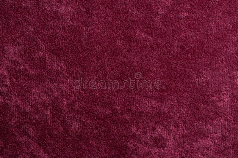 Red velvet background or velour flannel texture made of cotton or wool with soft fluffy velvety satin fabric cloth meta royalty free stock photo