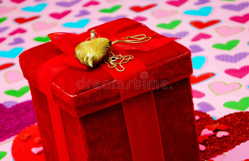 Red velvet box with heart necklace stock photo