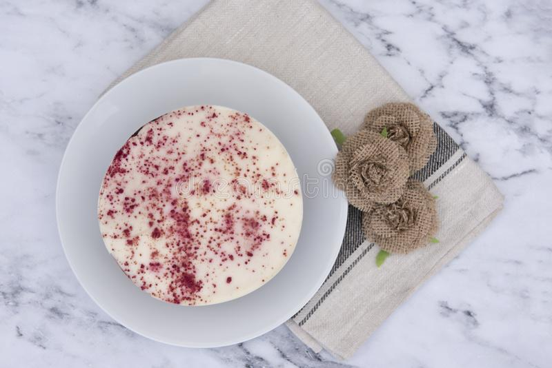 Red velvet cake, decorated with hessian flowers stock photos