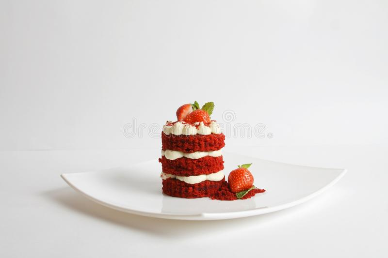 Red velvet cake on a plate isolated on white. stock image