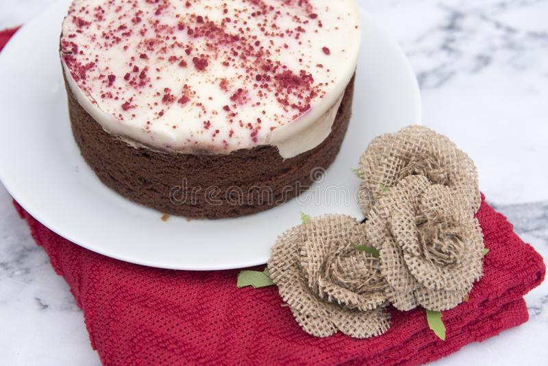 Red velvet cake, with a red cloth stock photos