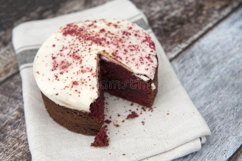 Red velvet cake with a slice missing stock image
