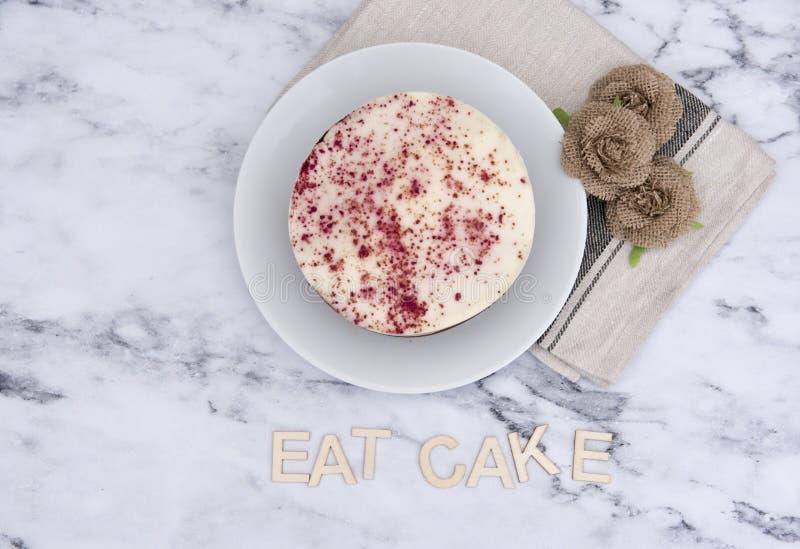 Red velvet cake with the words eat cake spelt underneath stock images