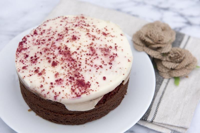 Red velvet cheesecake, decorated with hessian flowers stock photo