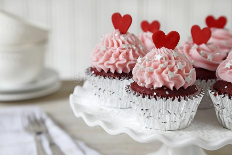 Red velvet cupcakes with red hearts royalty free stock images