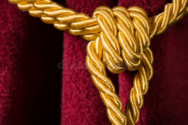 Red velvet curtain with tassel royalty free stock photography