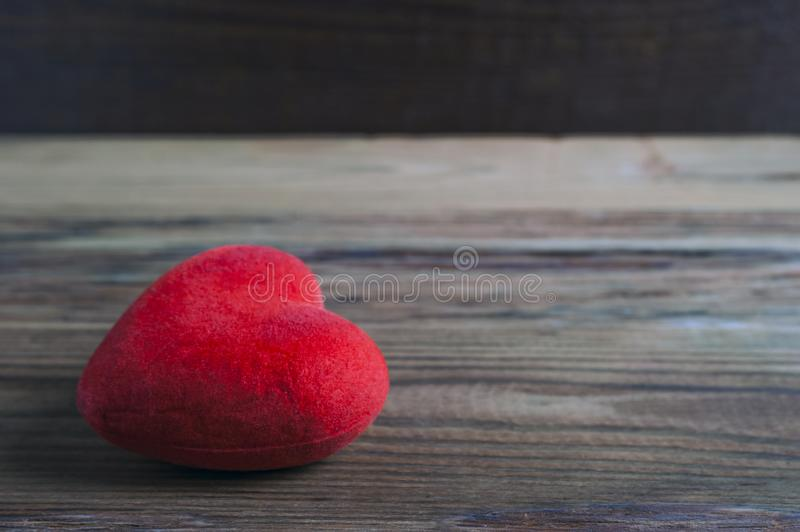 Red Velvet Heart Lying on a Rustic Wooden Surface. Saint Valentines Day, Love Card, Banner, Message Concept.  stock photos