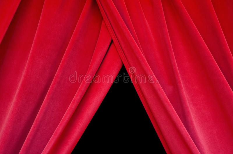 Red velvet theater curtain closes the black stage stock image