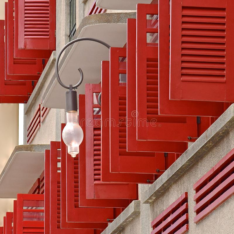 Red venetian shutters royalty free stock photo