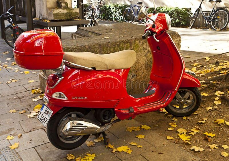 Jack Holt Red-vespa-parked-sidewalk-street-munich-germany-november-iconic-old-fashioned-italian-motorcycle-munich-46841041