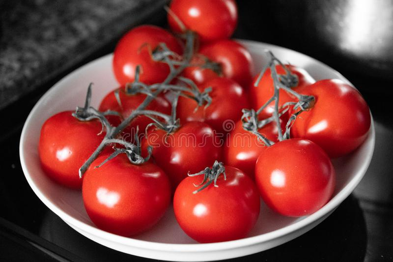 Red vine ripe tomatoes in a bowl royalty free stock photography