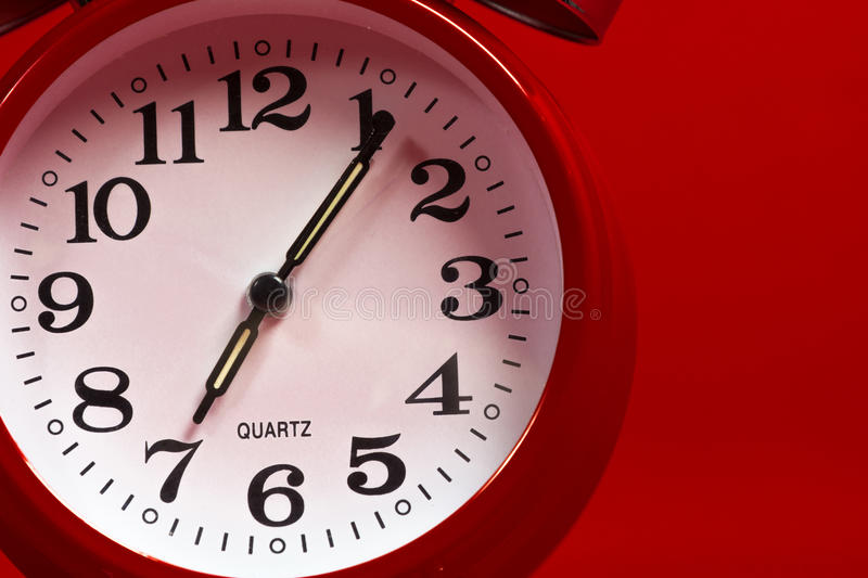 Download A Red Vintage Alarm Clock On A Red Background Stock Photo - Image of wake, hour: 39506522