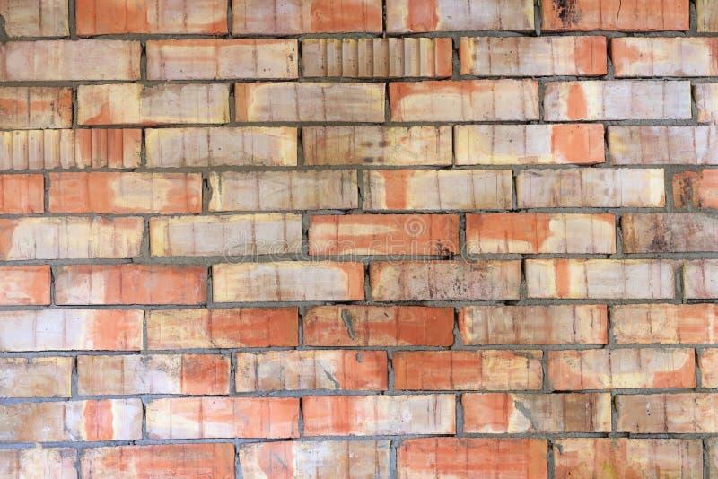 Red vintage brick wall. Old broken industrial texture. Background. Grunge street exterior stock photo
