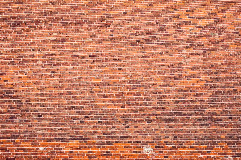 Red bricks wall background. Old building surface. Red vintage bricks wall background. Old building surface stock image