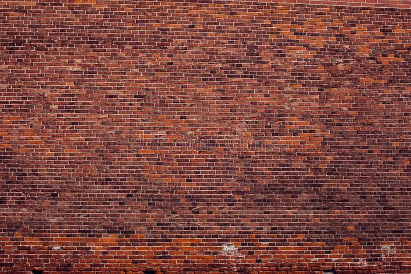 Red bricks wall background. Old building surface. Red vintage bricks wall background. Old building surface stock photo
