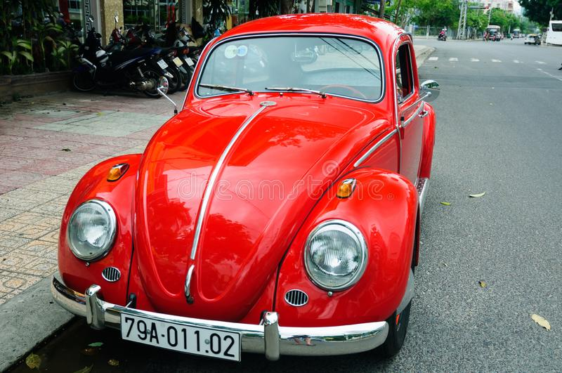 Red vintage car on the street. royalty free stock photo