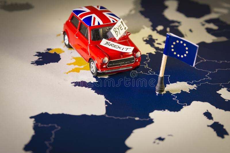 Red vintage car with Union Jack flag and brexit or bye words over an UE map and flag. royalty free stock photos
