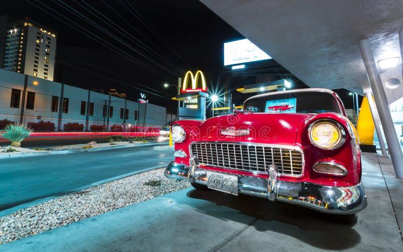 Red Vintage Chevrolet on The Strip at night, Las Vegas Boulevard, Las Vegas, Nevada, USA, North America royalty free stock photography