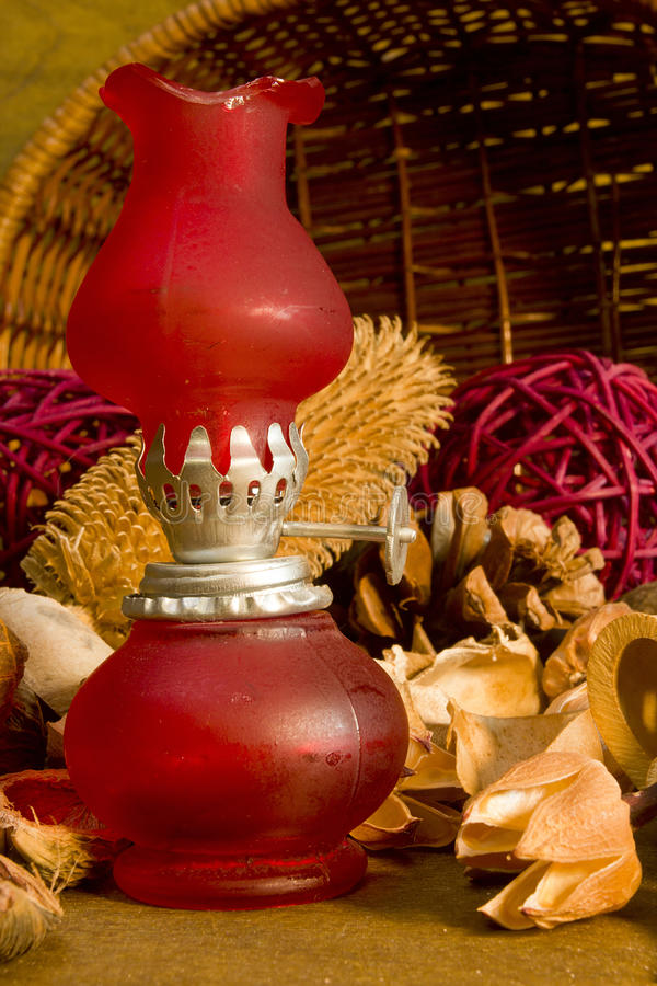 Red vintage gas lamp. On a background of dry potpourri royalty free stock image