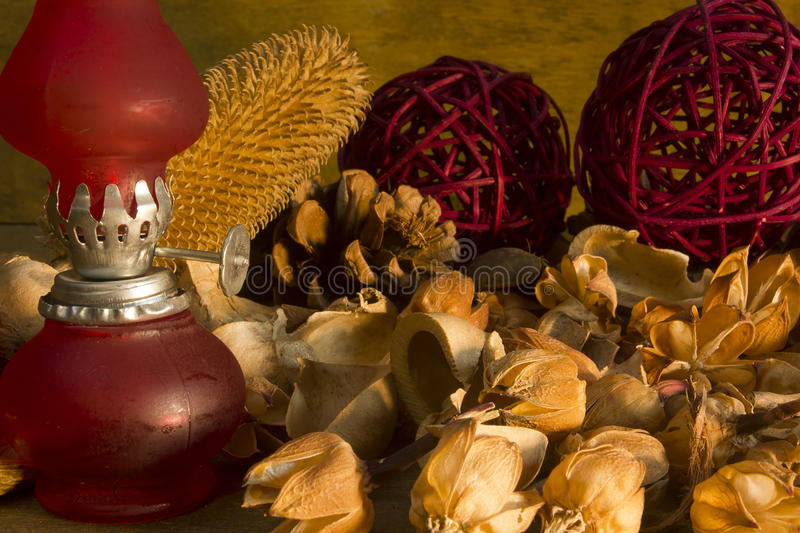 Red vintage gas lamp. On a background of dry potpourri royalty free stock photo