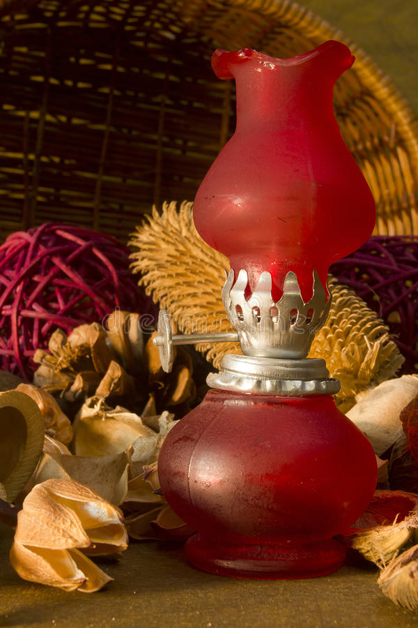 Red vintage gas lamp. On a background of dry potpourri stock photos