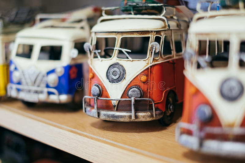 Red vintage old tiny toys wagon car on the shelf.  royalty free stock image