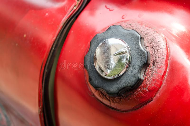 Red Vintage pick up truck oil tank cap in close up. stock photos